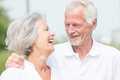 Active senior couple smiling and Stock Photo