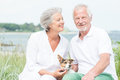 Active senior couple smiling and with dog Royalty Free Stock Photography