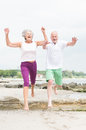 Active senior couple and sporty at the beach Royalty Free Stock Photo