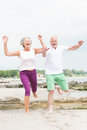 Active senior couple and sporty at the beach Royalty Free Stock Photography