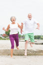 Active senior couple and sporty at the beach Royalty Free Stock Images