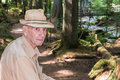 Active senior man hiking trail forest male portrait on deception falls in old growth Stock Image
