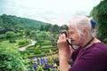 Active senior photographer Royalty Free Stock Photo