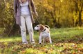 Active senior woman walks dog in nature Royalty Free Stock Photos