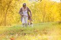 Active senior woman walks dog in nature Royalty Free Stock Images