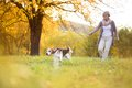 Active senior woman walks dog in nature Stock Photography