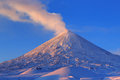 Active volcano of Kamchatka: eruption Klyuchevskoy Volcano at sunrise Royalty Free Stock Photo