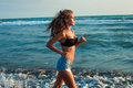 Active woman at beach Royalty Free Stock Photo