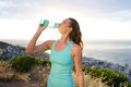 Active woman drinking from water bottle in front of the sea Royalty Free Stock Photo