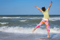 Active woman having fun on beach Royalty Free Stock Photo