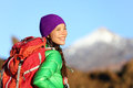 Active woman hiker living healthy lifestyle hiking outdoors wearing backpack smiling happy beautiful female trekking with looking Stock Photo