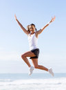 Active woman jumping young outdoors Stock Photos