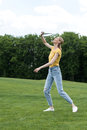 Active woman playing badminton game in park, summertime concept Royalty Free Stock Photo