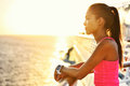 Active woman relaxing after run on cruise holiday ship looking at the sea during summer holidays asian runner girl wearing Stock Photos