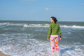 Active woman walking in the surf line Royalty Free Stock Photo