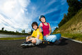 Active young people rollerblading skateboarding girl and boy roller skating Stock Image