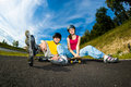 Active young people rollerblading skateboarding girl and boy roller skating Royalty Free Stock Photography