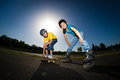 Active young people rollerblading skateboarding girl and boy roller skating Stock Photo