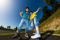 Active young people rollerblading skateboarding girl and boy roller skating Royalty Free Stock Photos