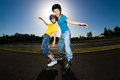 Active young people rollerblading skateboarding girl and boy roller skating Royalty Free Stock Photo