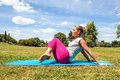 Active young woman working out to keep fit on exercise mat Royalty Free Stock Photo