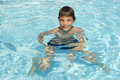 Activities on the pool boy swimming and playing in water i cute Royalty Free Stock Photography