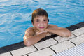 Activities on the pool boy swimming and playing in water i cute Stock Image