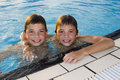 Activities on the pool boys swimming and playing in water cute Royalty Free Stock Photography