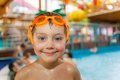 Activities on the pool portrait of cute boy swimming and playing in water in swimming Royalty Free Stock Images
