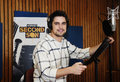 Actor in recording studio for a video game portuguese diogo morgado giving voice to delsin rowe the new version of infamous second Royalty Free Stock Image