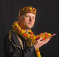 Actor with toy snake on a black background Royalty Free Stock Images