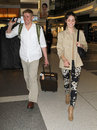 Actress Emmy Rossum & boyfriend Tyler Jacob at LAX Royalty Free Stock Photos