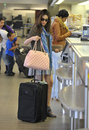 Actress Emmy Rossum is seen at LAX airport Stock Photography