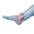 Acute pain in ankle woman holding hand to spot of ankle aches a Stock Photo