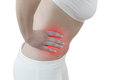 Acute pain in a woman abdomen female holding hand to spot of ache concept photo with color enhanced blue skin with read Stock Images