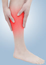 Acute pain in a woman calf Royalty Free Stock Photography