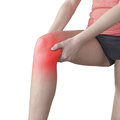 Acute pain in a woman knee holding hand to spot of aches Royalty Free Stock Images