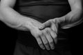 Acute pain in a wrist male man holds his hand monochrome image Royalty Free Stock Images