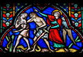 Adam and eve expelled from the garden of eden on a stained glass window in the cathedral of brussels belgium Royalty Free Stock Photo