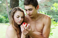 Adam and eve with a red apple Royalty Free Stock Photography