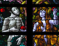 Adam and eve stained glass a photo of Royalty Free Stock Photo