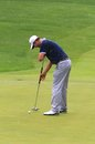 Adam scott on the pga tour uses his long putter green at professional golf tournament event northeast ohio united states Royalty Free Stock Image