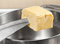 Add butter to pan knife Royalty Free Stock Photography
