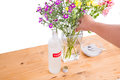 Add vodka and sugar into vase to keep flowers fresher few drops of filled with water cut Royalty Free Stock Photo