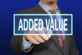Added value concept business image of a businessman clicking button on virtual screen over blue background Royalty Free Stock Photo