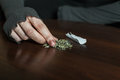 Addict hands making marijuana jamb closeup. Royalty Free Stock Photo