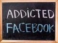 Addicted facebook word on blackboard Royalty Free Stock Photo