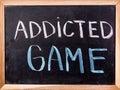 Addicted game  word on blackboard Royalty Free Stock Photo