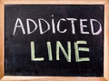 Addicted line  word on blackboard Royalty Free Stock Photo