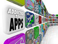 Addicted to apps words mobile software tile display on app tiles illustrate our growing reliance on application and on devlices Stock Images
